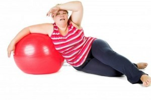 10043020-tired-fat-woman-with-big-red-gymnastic-ball